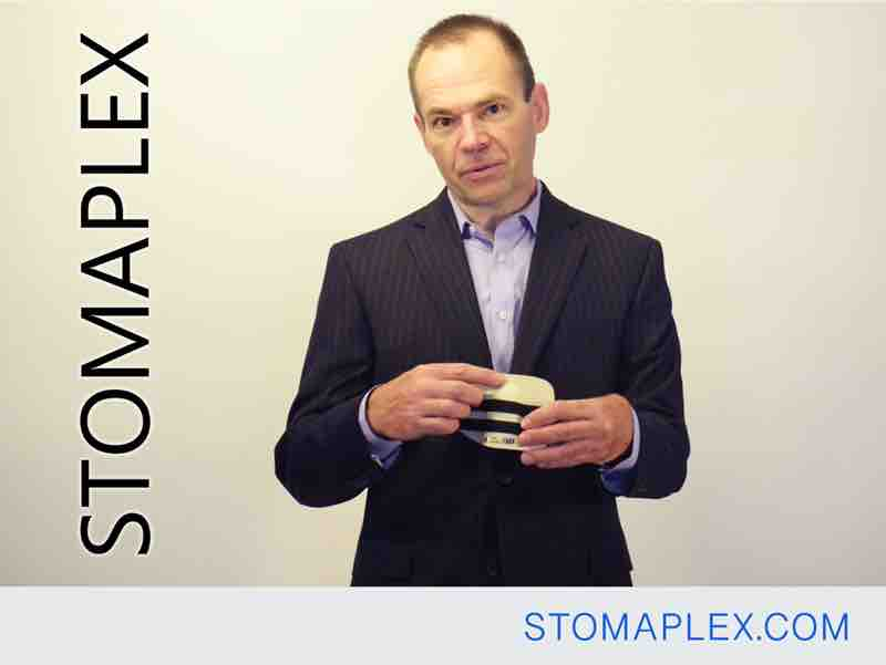 mens ostomy clothing, a man in a suit who needs it to have free flow stoma protector, by stomaplex