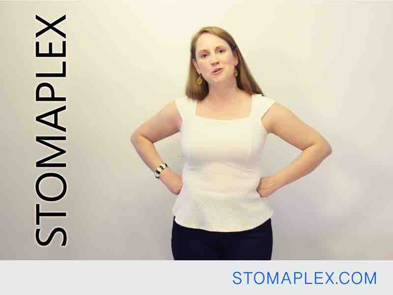 women with stoma guard and ostomy belt is ready to go back to work with an ileostomy, by stomaplex, bag support belt