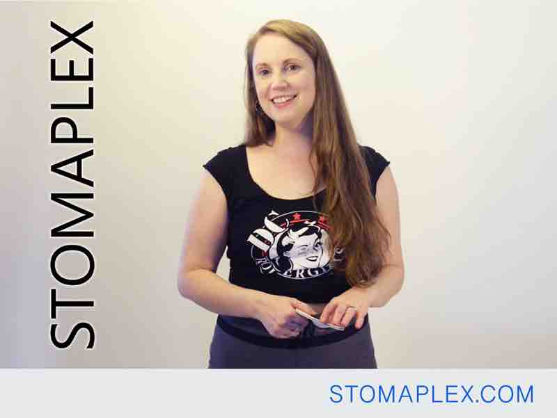 parastomal hernia support belt on a woman with an ileostomy in bike shorts by stomaplex